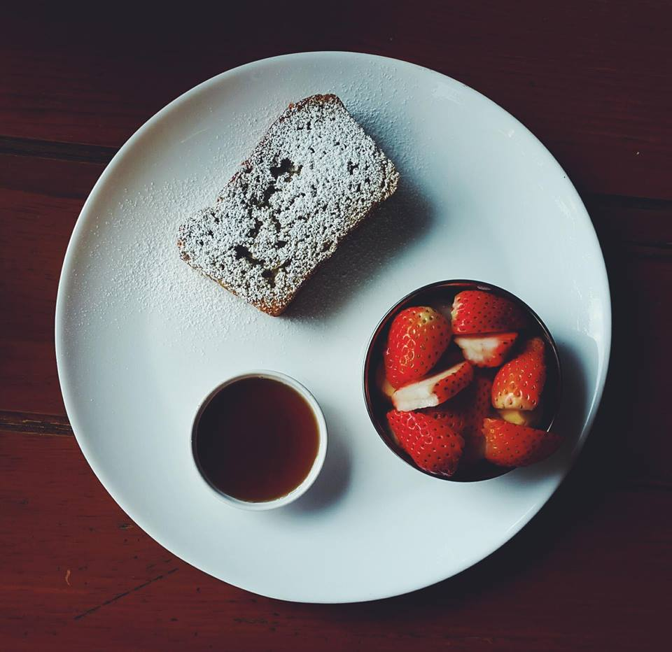 Toasted banana bread with maple syrup and strawberries cafe soma