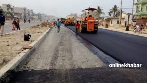 Govt claims it blacktopped 2.5 km road a day through past one year