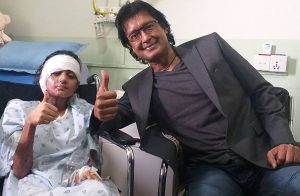 Rajesh Hamal at hospital to motivate Birgunj acid attack survivor