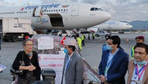 30,000 test kits stuck in Malaysia arrive in Nepal; Swiss envoy hands over to minister