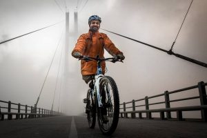 Yam Lal Rasaily cycles to prove his independence as a single-leg amputee