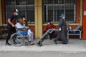 Covid-19 Nepal: Underpaid health workers do their best to save lives at Kathmandu's ill-equipped hospital