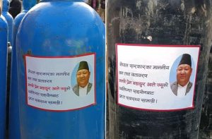 'Viral minister' Ale sticks his own pic on oxygen cylinders including ones received as aid