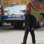 As Kathmandu lockdown begins, dozens such as this septuagenarian walk kilometres to go home
