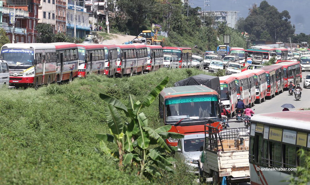 Kathmandu public transport operators park their buses on the roadside as they launch a strike, in Kathmandu, on Monday, October 4, 2021